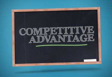 competitive advantage: Competitive advantage written on a chalkboard and underlined in green