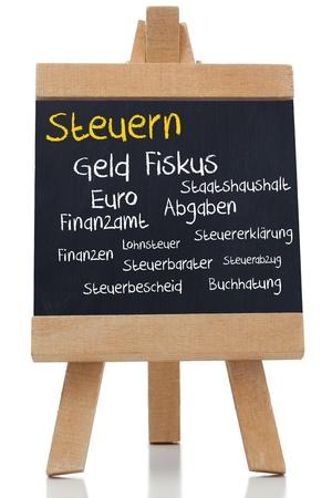 geld: Tax written germman in yellow with a chalk on blackboard on white background Stock Photo
