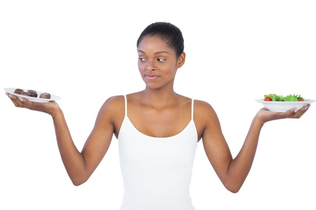 healthily: Woman deciding to eat healthily or not on white background