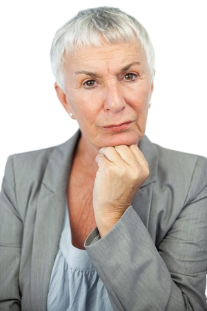 thoughful: Thoughful woman looking at camera on white background Stock Photo