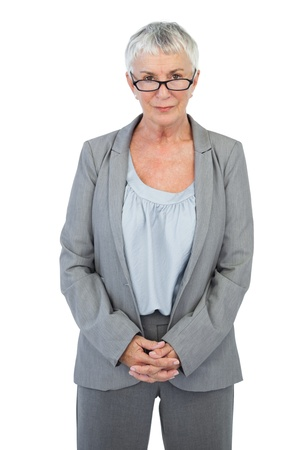 Serious businesswoman with glasses on white background photo