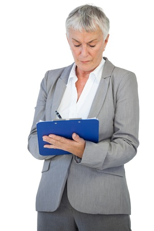 noting: Businesswoman using her clipboard on white background
