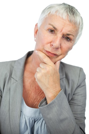 Thinking woman looking at camera on white background photo