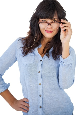 Cute woman wearing glasses with her hand on hip on white background photo