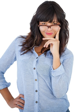 Beautiful woman wearing glasses with her hand on hip on white background photo