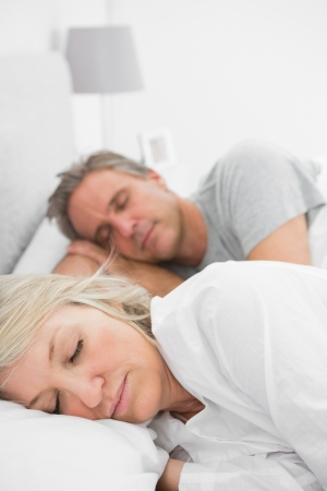 Couple sleeping peacefully at home in bed photo