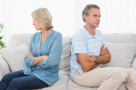 Couple not taking after a fight at home on couch photo