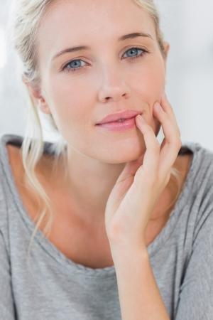 Beautiful blonde woman smiling at the camera photo