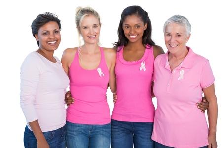 白地にピンクのトップスと乳房がんリボン身に着けている女性の笑みを浮かべてください。 写真素材