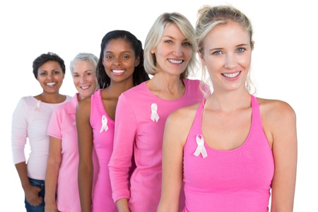cancer symbol: Smiling women wearing pink and ribbons for breast cancer on white background