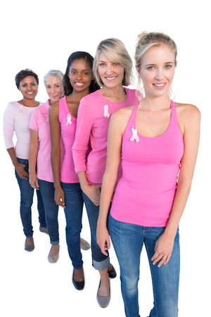 cancer ribbon: Happy women wearing pink and ribbons for breast cancer on white background Stock Photo