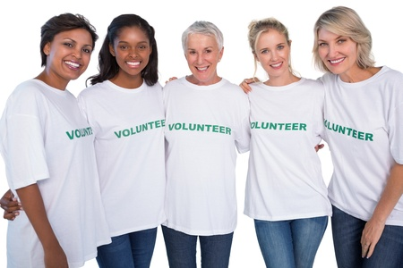 tshirts: Group of female volunteers smiling at camera on white background