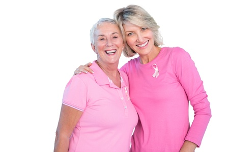 cancer symbol: Mature women wearing pink tops and ribbons for breast cancer on white background