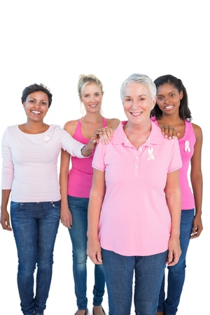 Supportive women wearing pink tops and breast cancer ribbons on white background