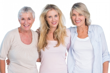 grandmother mother daughter: Three generations of  happy women smiling at camera on white background Stock Photo
