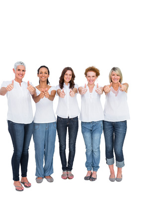 Cheerful casual models with thumbs up on white background photo