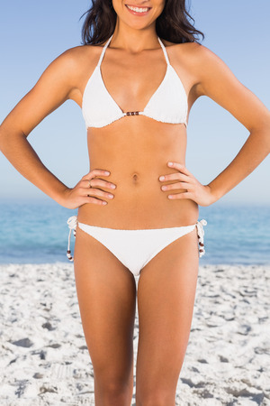 tanned body: Perfect tanned body of attractive young woman on the beach Stock Photo