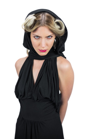 Frowning creepy blonde wearing black clothes posing on white background photo