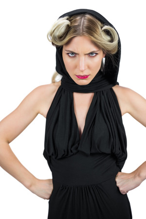 Domineering creepy blonde wearing black clothes frowning while posing on white background photo