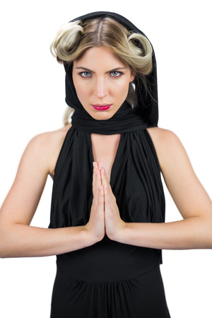 Relaxed mysterious blonde wearing black clothes posing on white background photo
