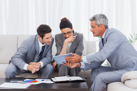 Business people working together on sofa at office photo