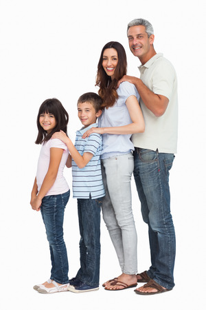 Portrait of a cute family in single file on white background photo