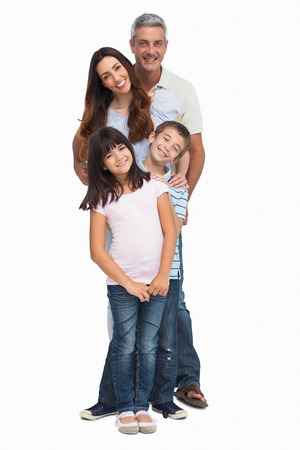 Portrait of a smiling family in single file on white background photo