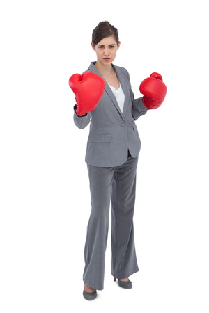 Competitive woman with red boxing gloves on white background photo