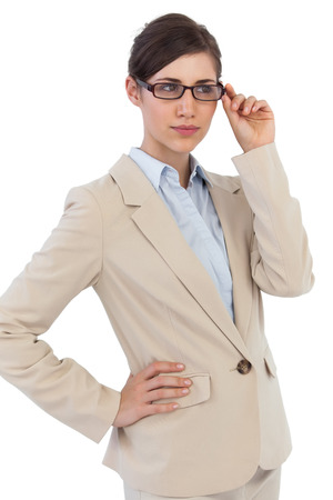 Young businesswoman with glasses against white background photo