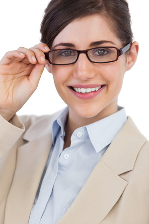 Cheerful businesswoman against white background holding her glasses photo