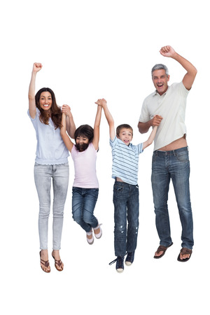 Cheerful family jumping against white background photo