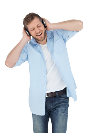 Trendy model on white background listening to music photo