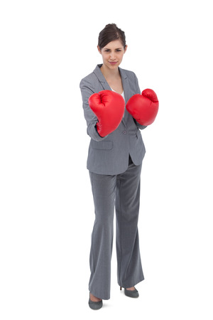 Competitive woman with boxing gloves on white background photo