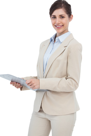 Smiling businesswoman with clipboard on white background  photo