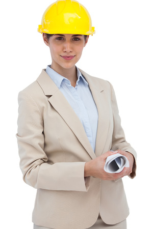 Architect with hard hat holding plan on white background  photo