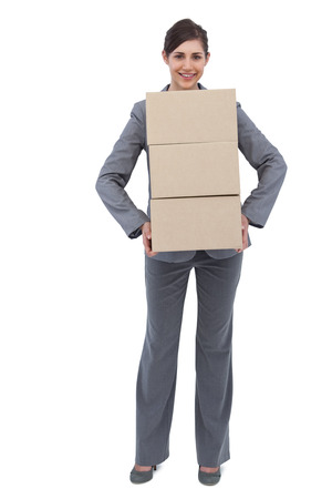 Smiling businesswoman  on white background  carrying cardboard boxes photo