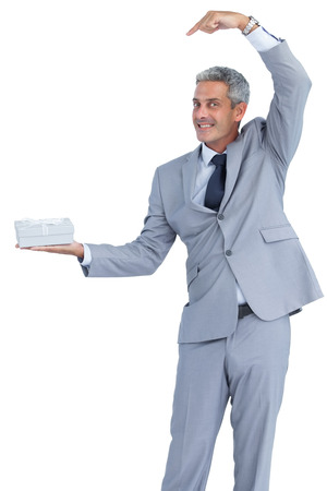 Funny businessman on white background offering gift photo