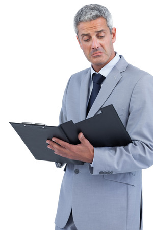 dissapointed: Disappointed businessman on white background holding clipboard Stock Photo