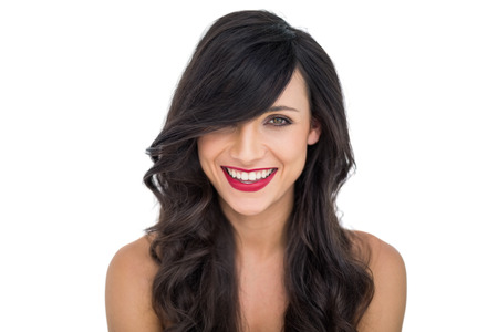 dark haired woman: Cheerful dark haired woman posing  on white background