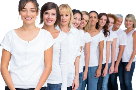 Cheerful models posing in a line on white background photo