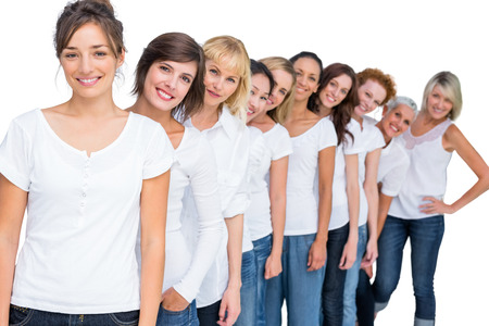 Cheerful casual models posing in a line looking at camera on white background photo