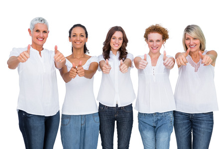 Cheerful casual models posing together with thumbs up on white background photo