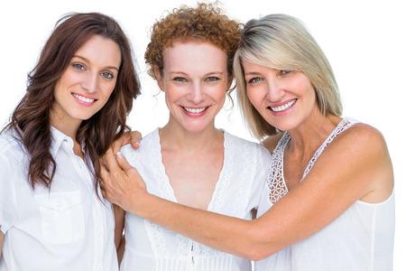 schöne frauen: Schöne Modelle posiert umarmen einander auf weißem Hintergrund Lizenzfreie Bilder