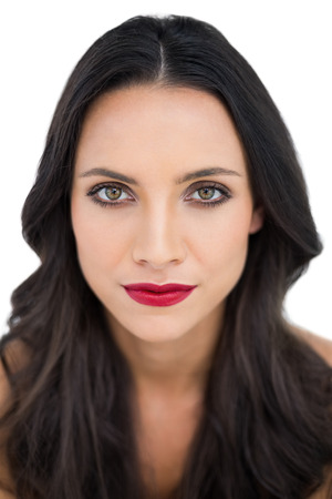 dark haired woman: Dark haired woman with red lips on white background