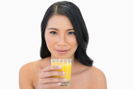 Sensual   model holding orange juice on white background photo