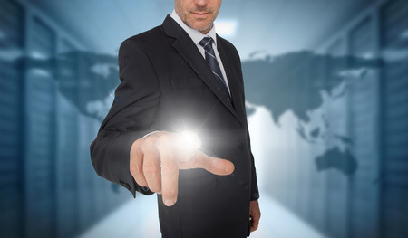 international business center: Businessman touching futuristic interface with world map and data center on background