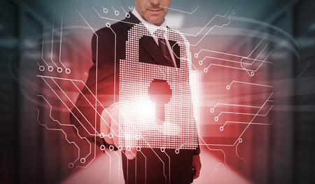 lock  futuristic: Imprenditore toccando serratura e il circuito di interfaccia futuristica nel data center