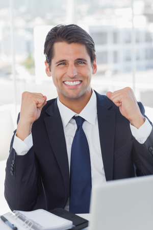 Successful businessman looking at camera in his office photo