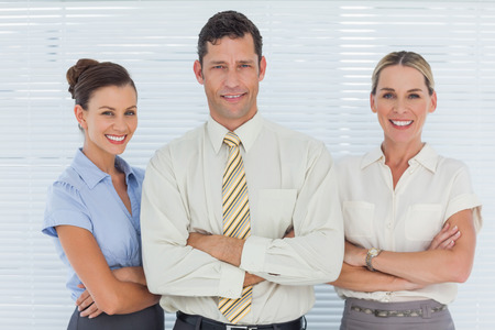 Cheerful coworkers posing together in bright office photo