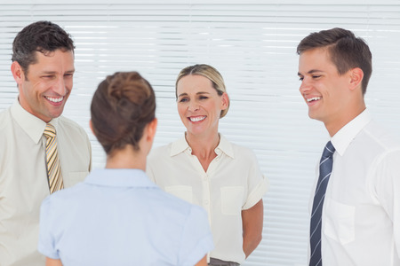 having a break: Smiling coworkers having a break together in staff room Stock Photo